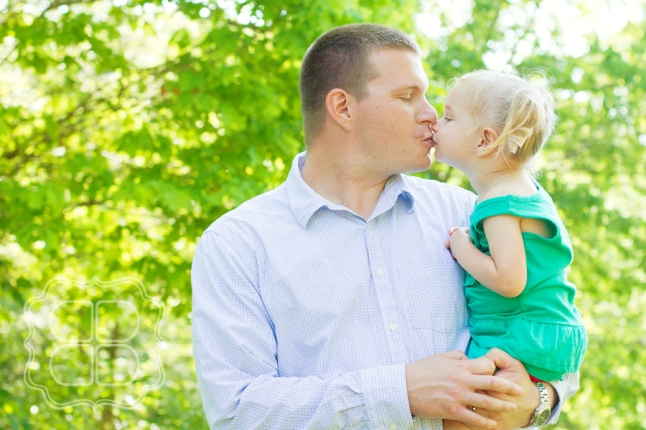 Child and her father share a kiss in this Charlotte photographer's picture.
